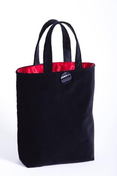 black velvet bag with red satin lining