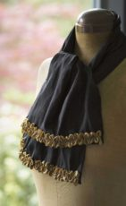 black silk scarf with gold ribbon trims and blue beads
