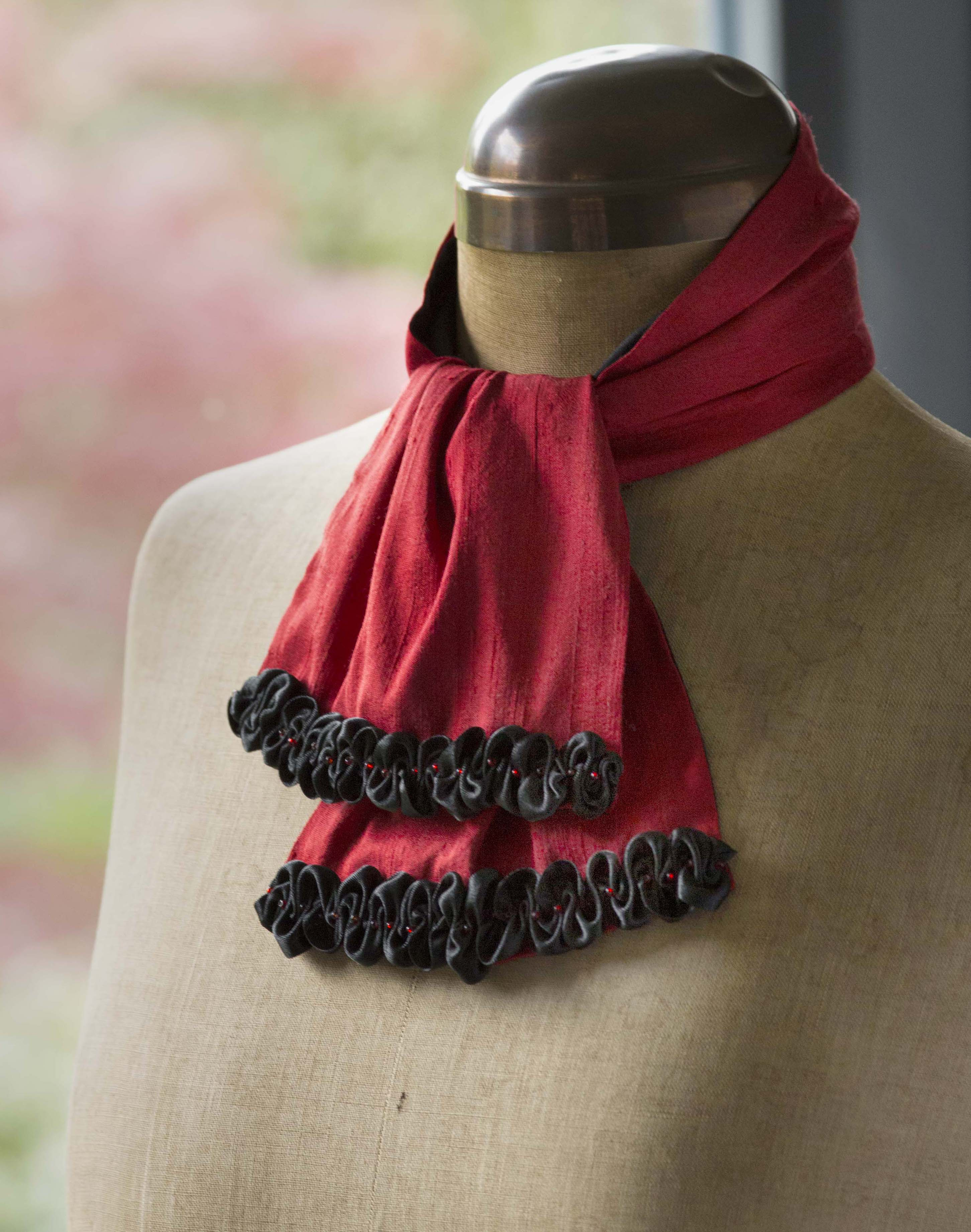 Red silk scarf with black ribbon trim