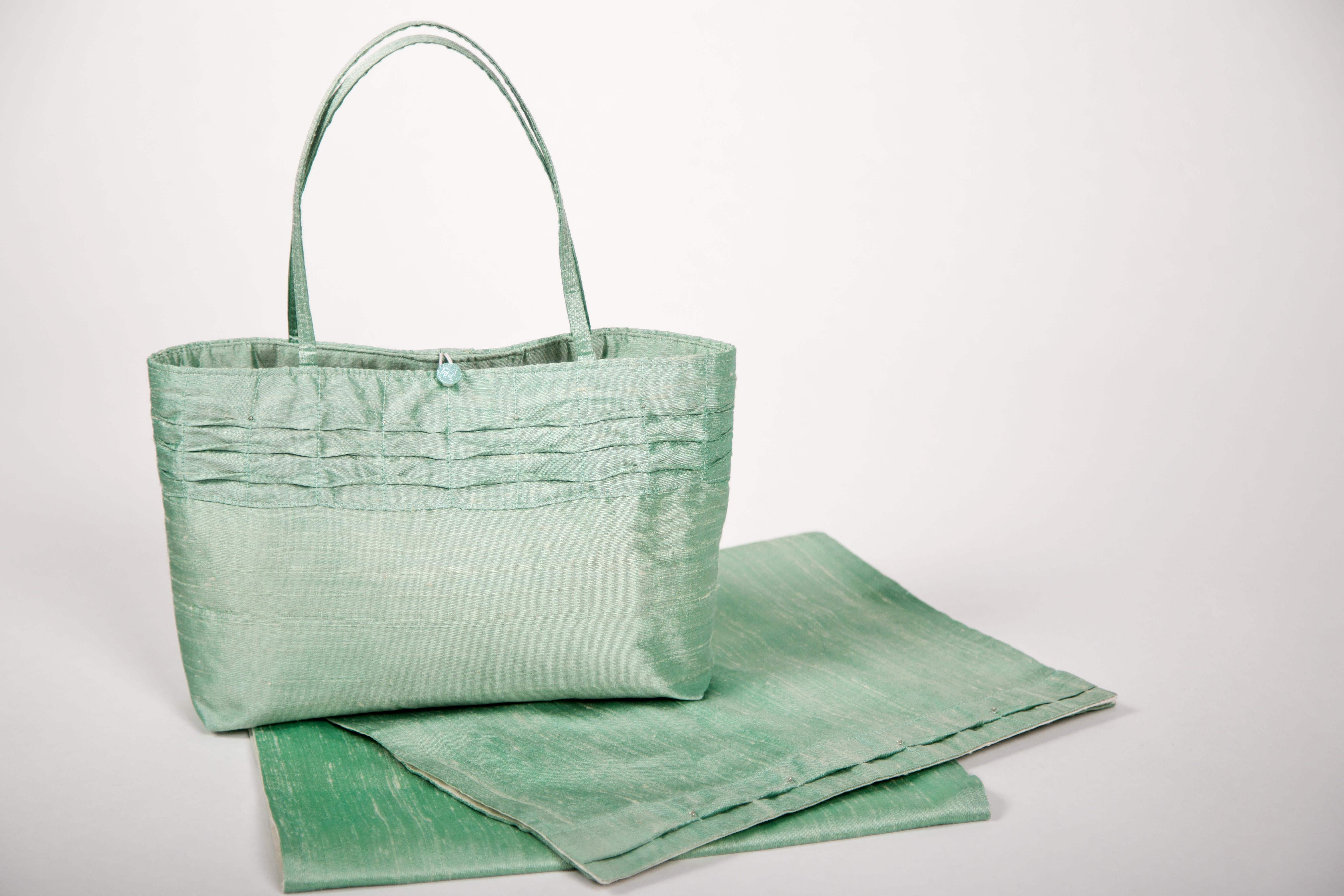 Green silk handbag and matching wrap