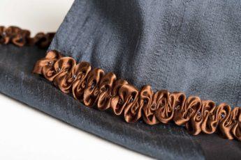 Brown satin ruched ribbon on gunmetal blue silk scarf
