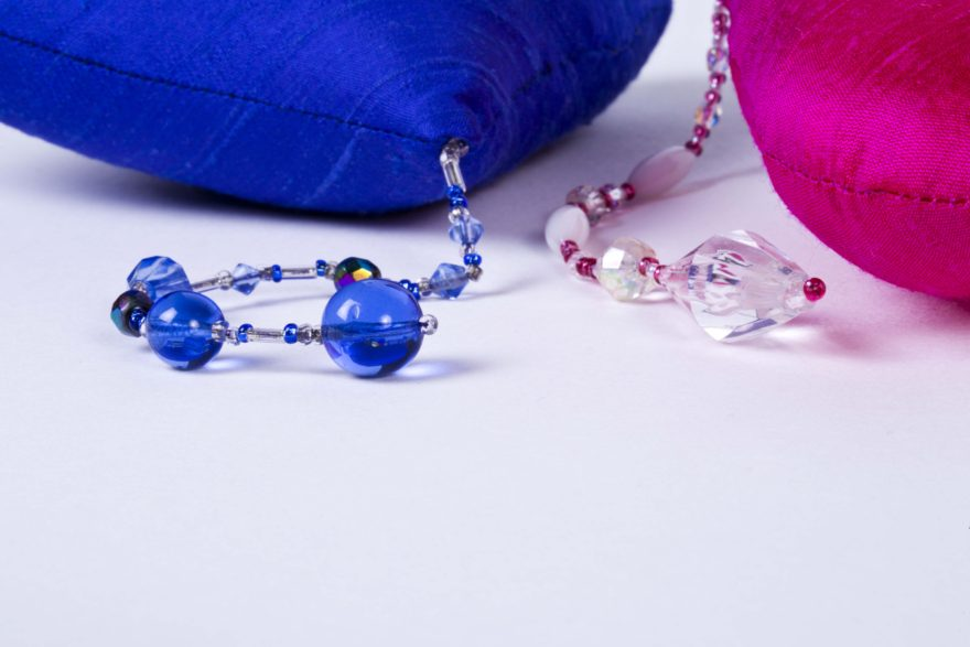 bead detail of pink and blue silk hearts
