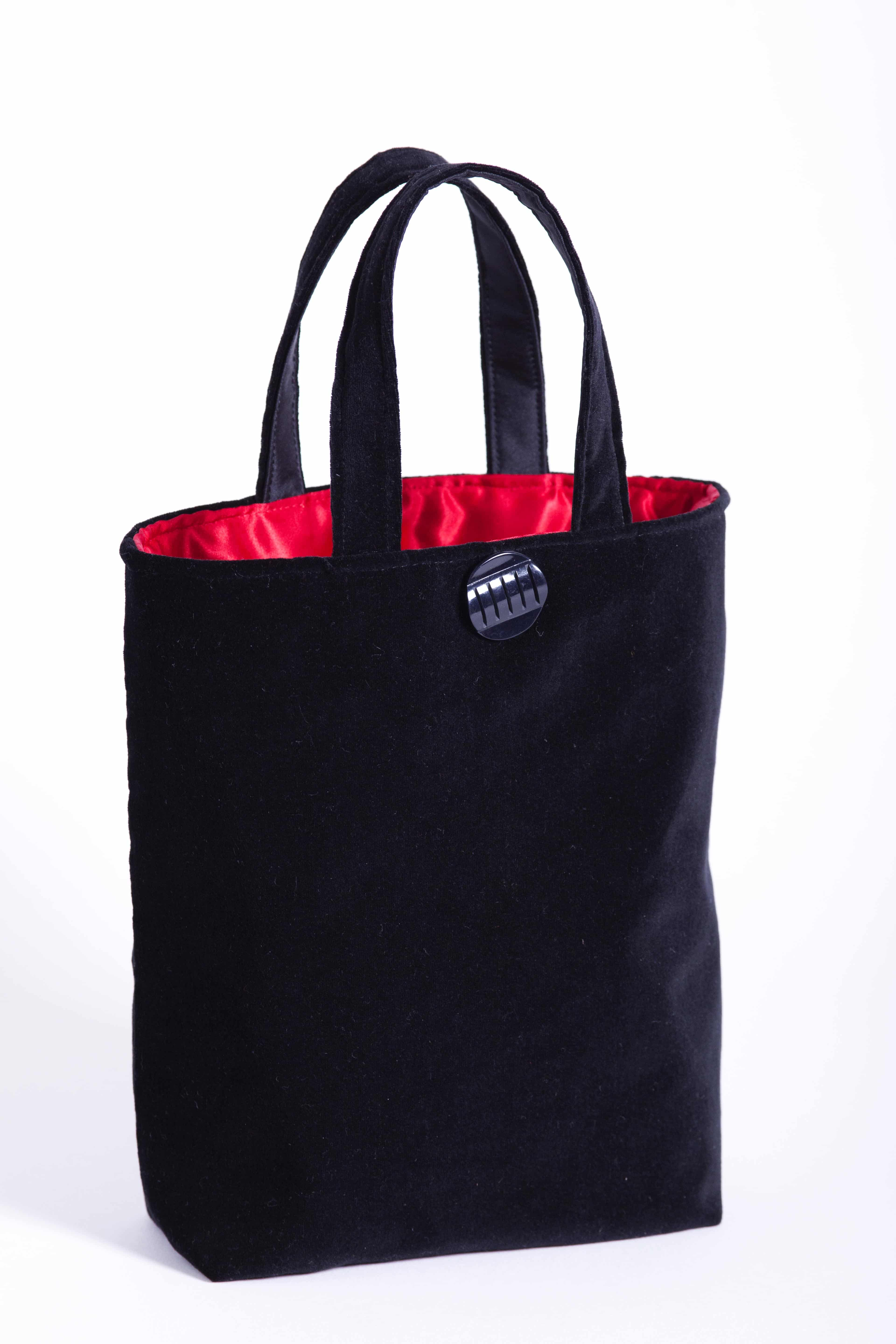 black velvet bag with red satin lining