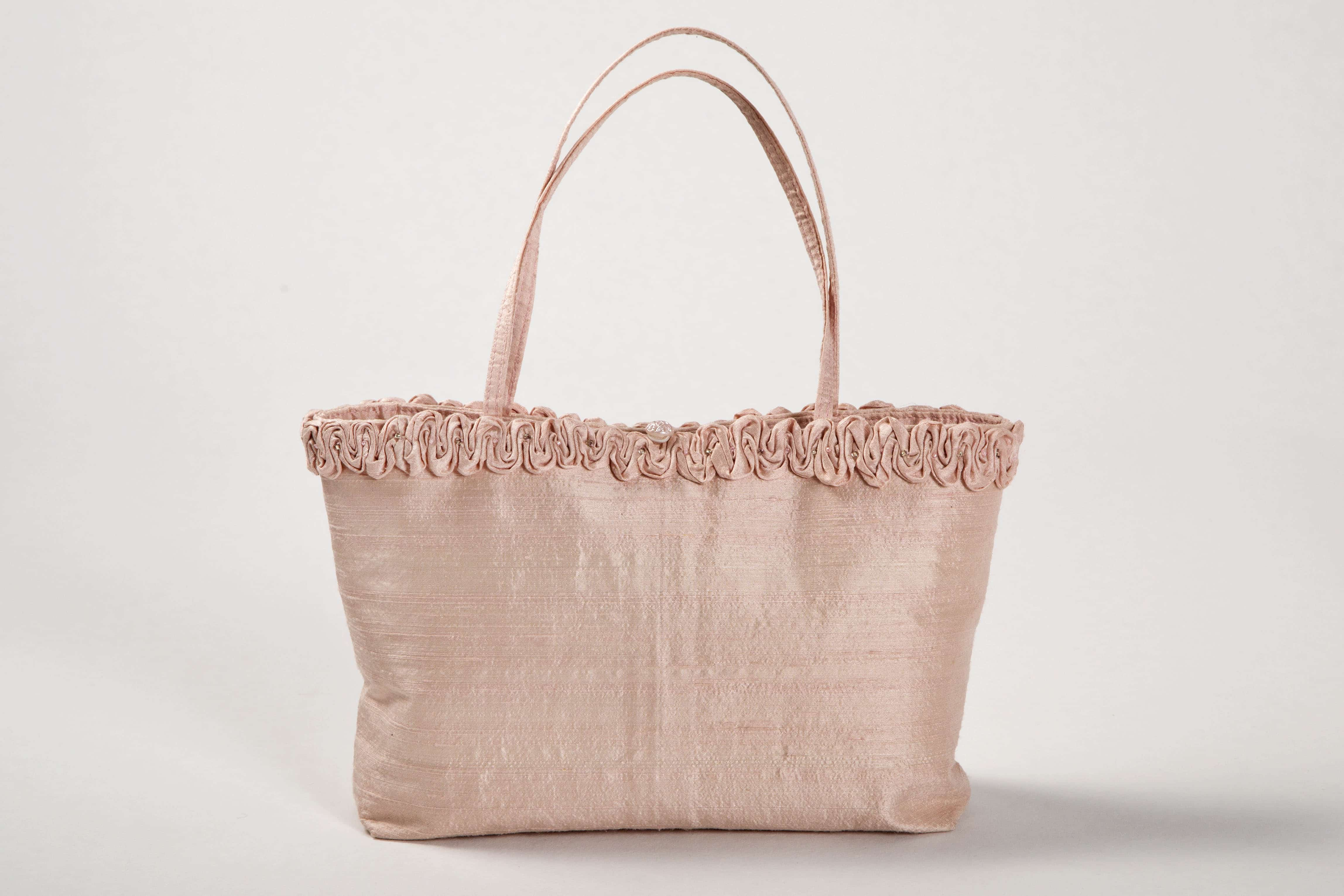 Pale pink silk handbag