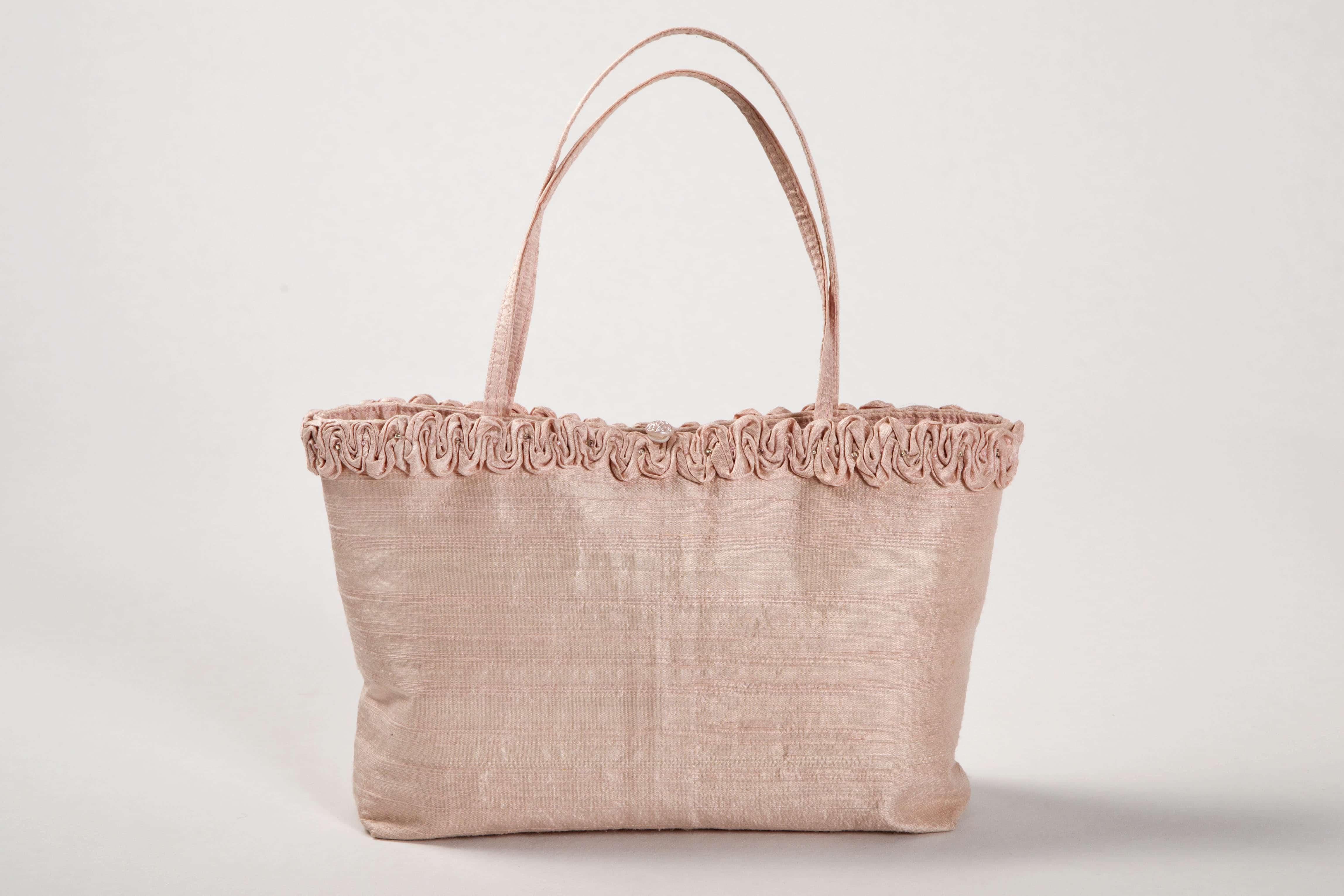 Pale pink silk handbag