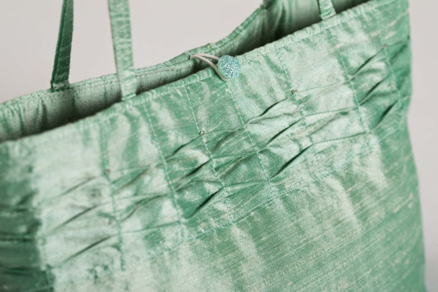 green silk bag close up