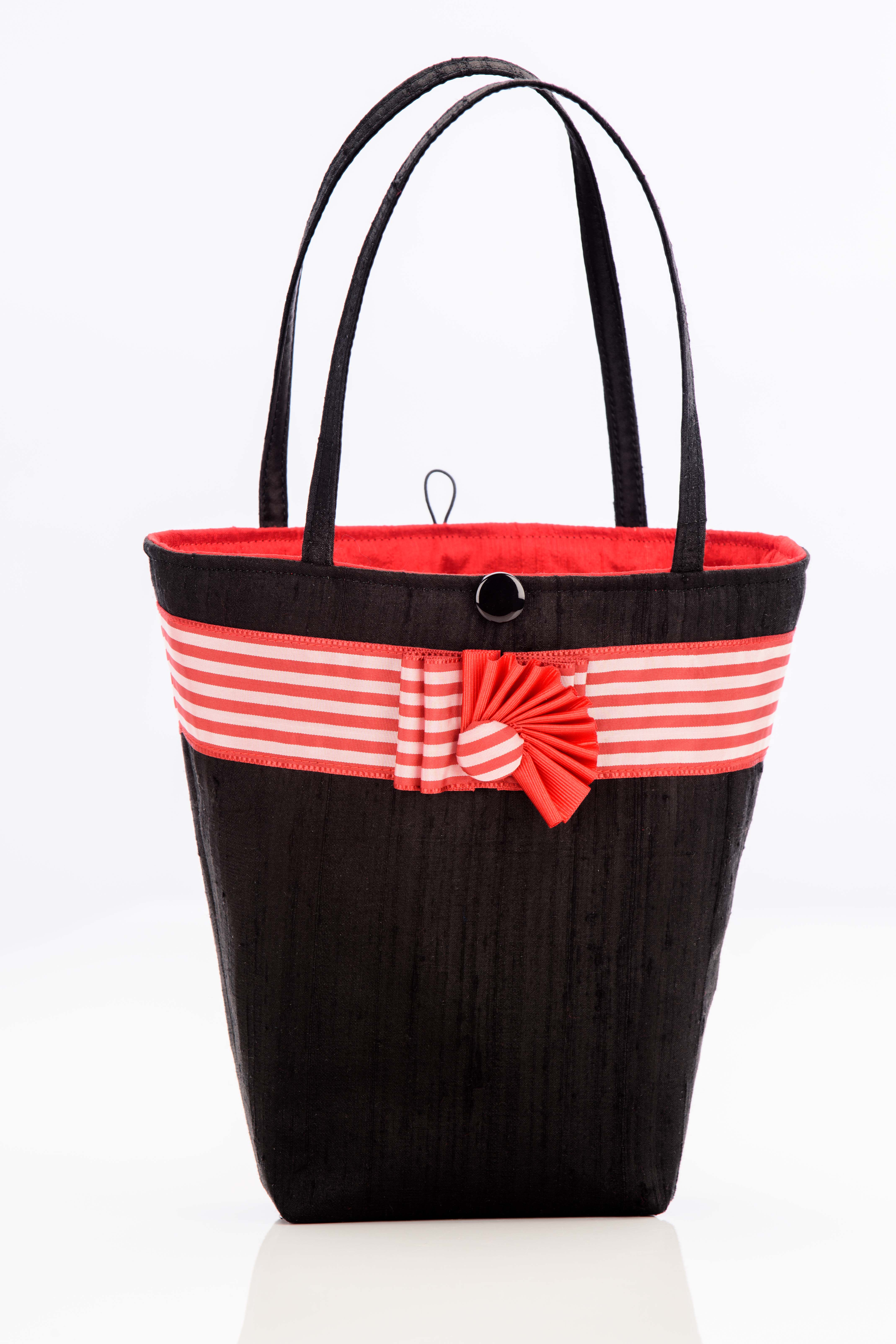 Black silk handbag with red and white striped trim