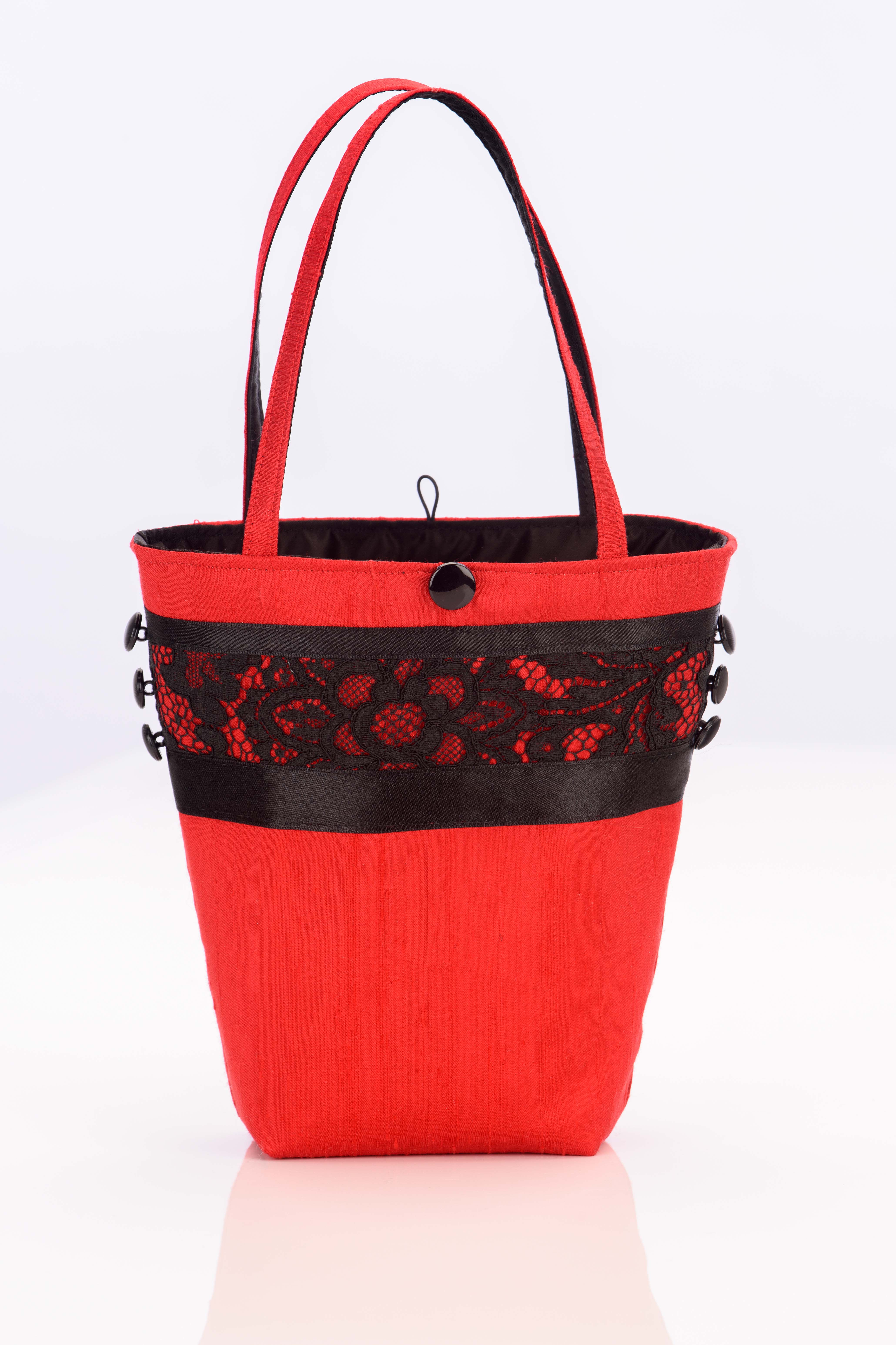 Red silk handbag with vintage black lace