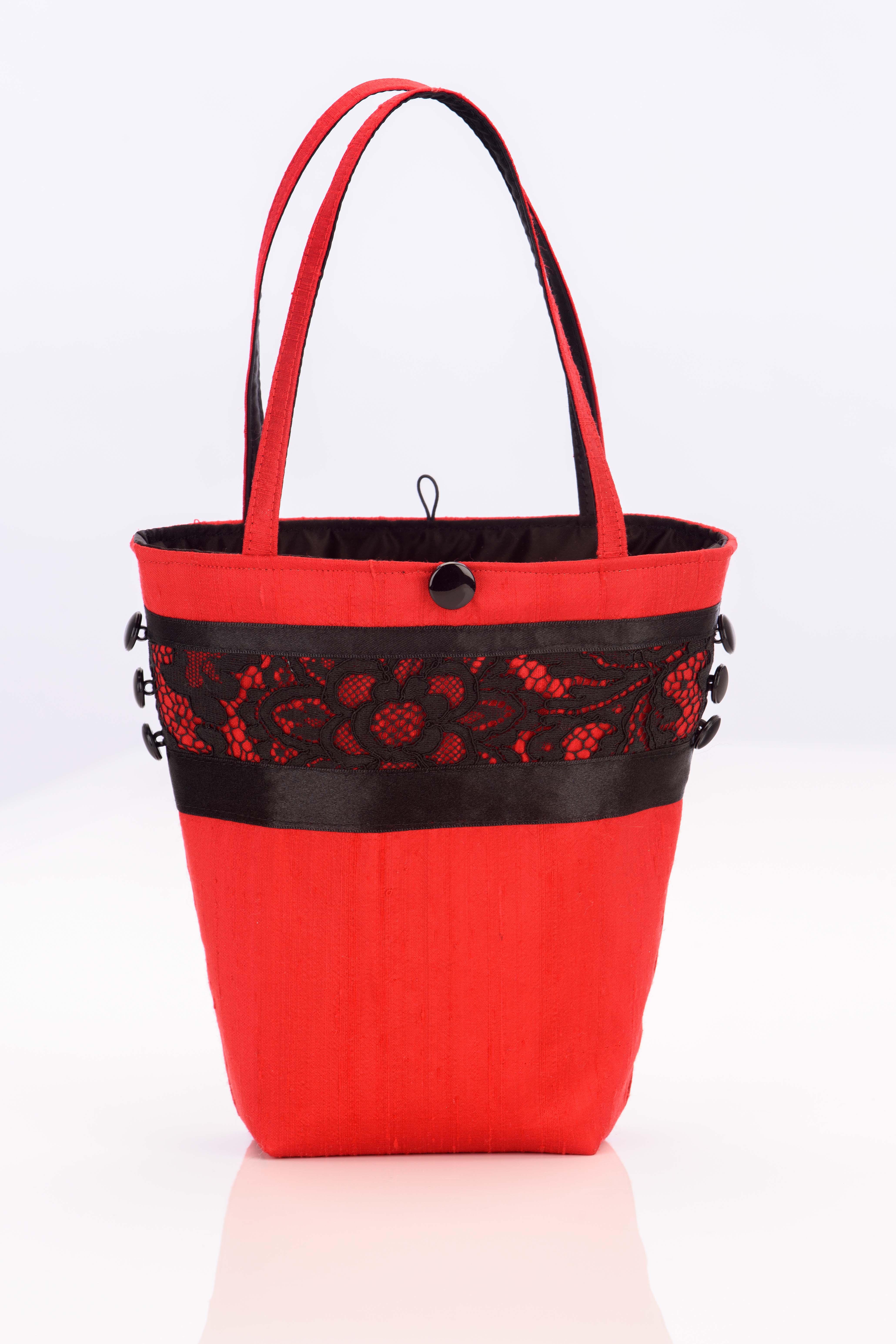 Red silk handbag with vintage black lace