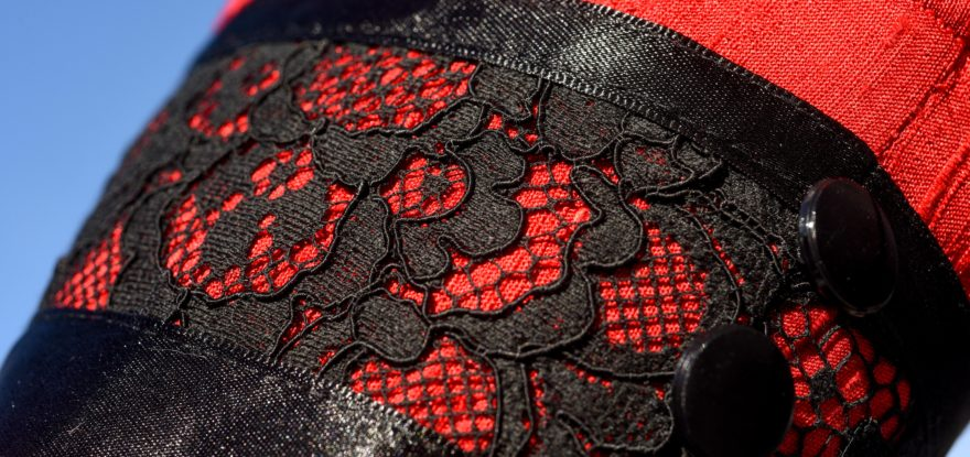 Black lace detail on red silk