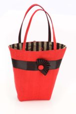 red silk handbag with grey and black striped lining