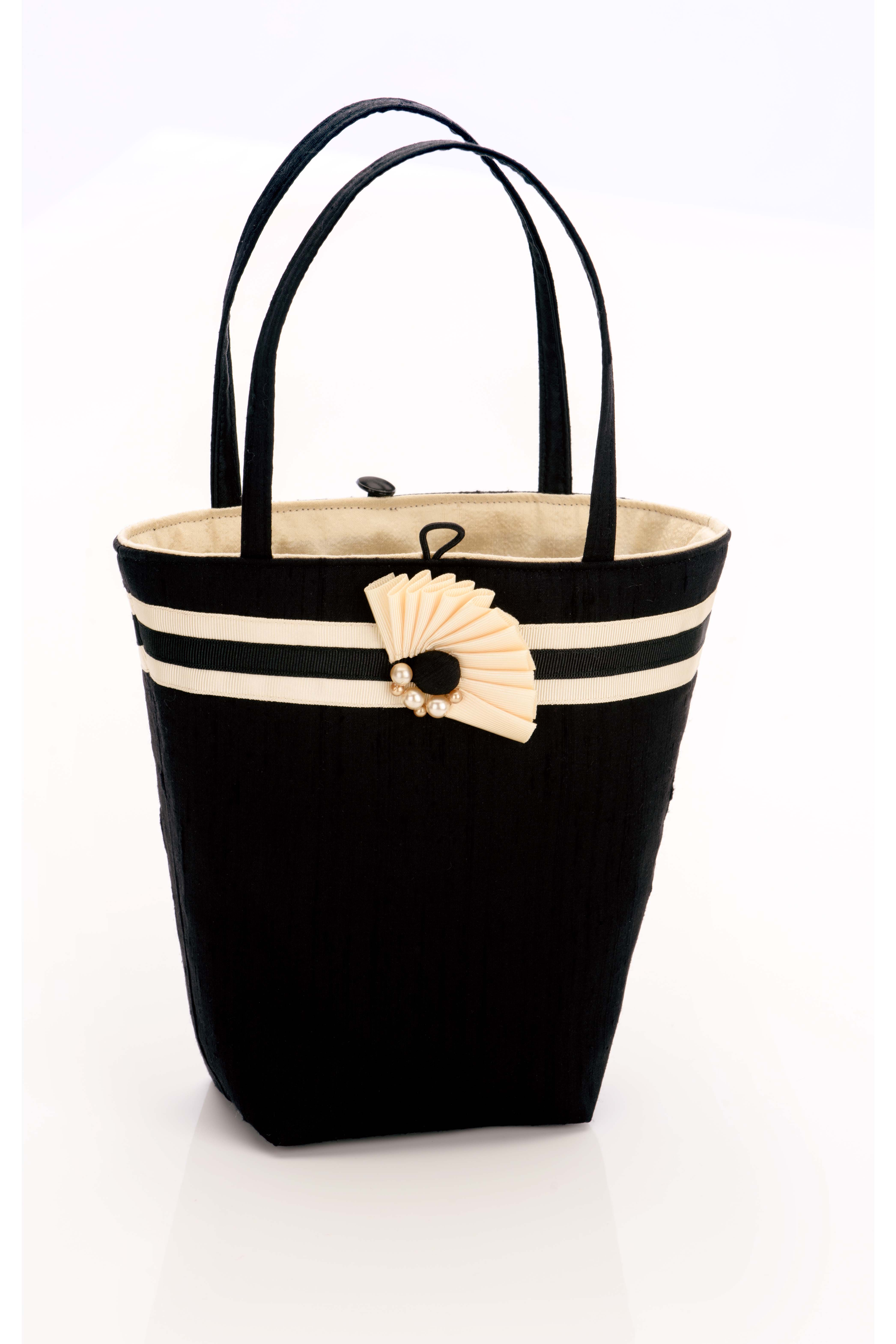 Black silk handbag with black and cream trim