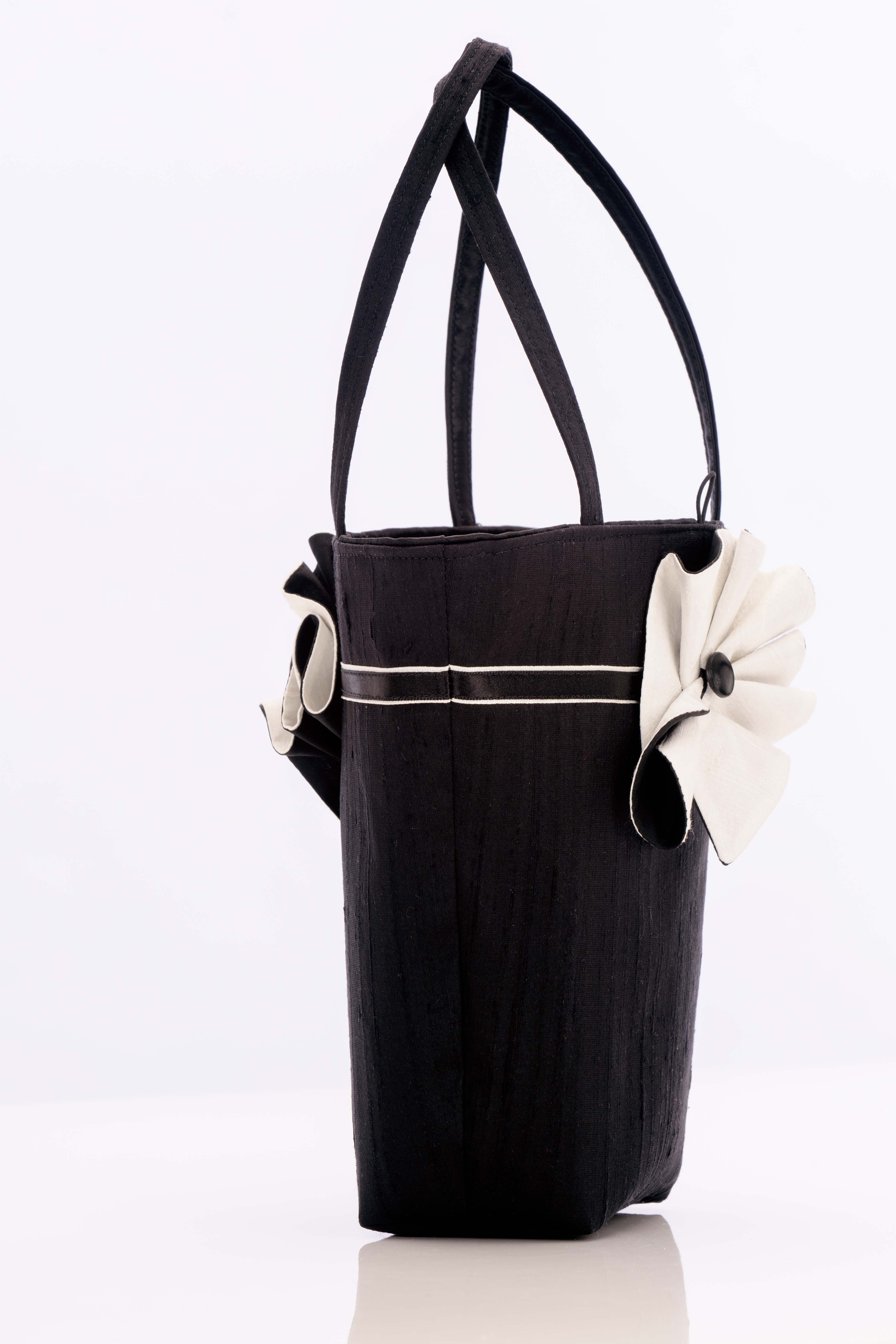 Black silk handbag with black and white swirl trim