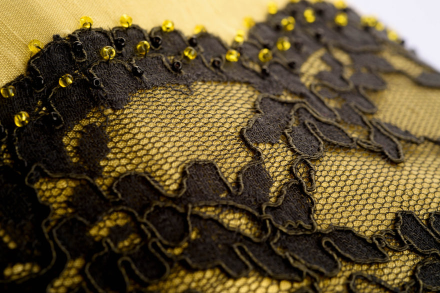 Close up detail of yellow bag with lace