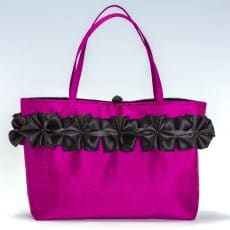Pink silk handbag with black ribbon trim