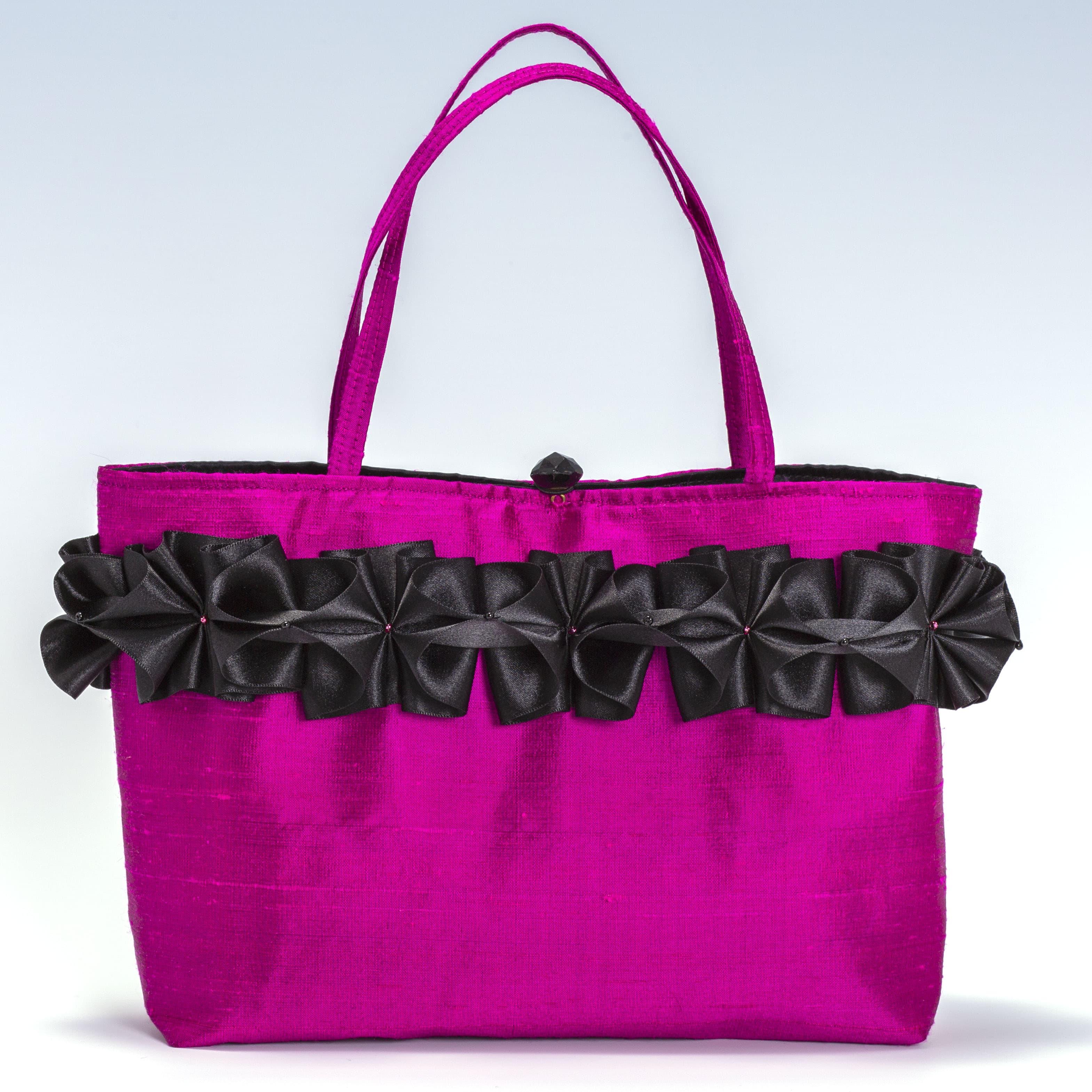 Pink silk handbag with black ribbon trim