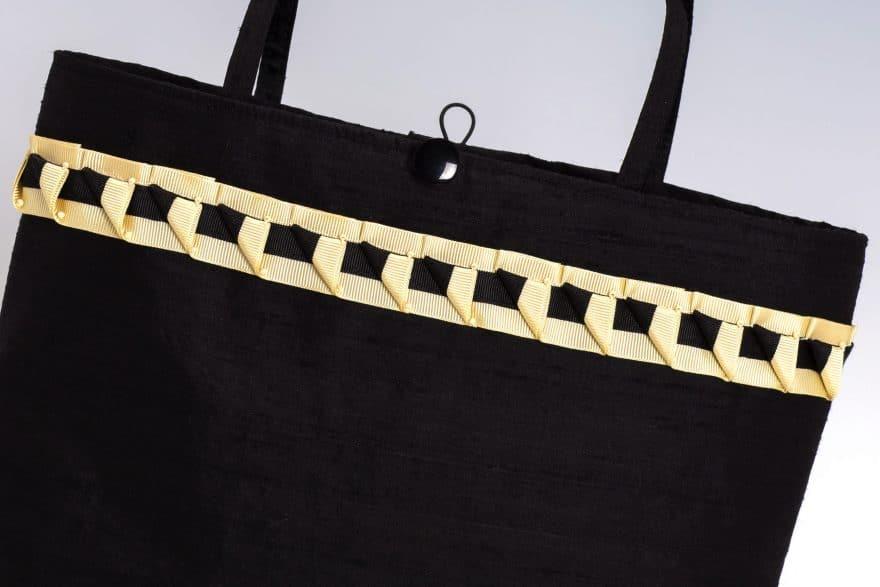 detail of cream trim on handbag