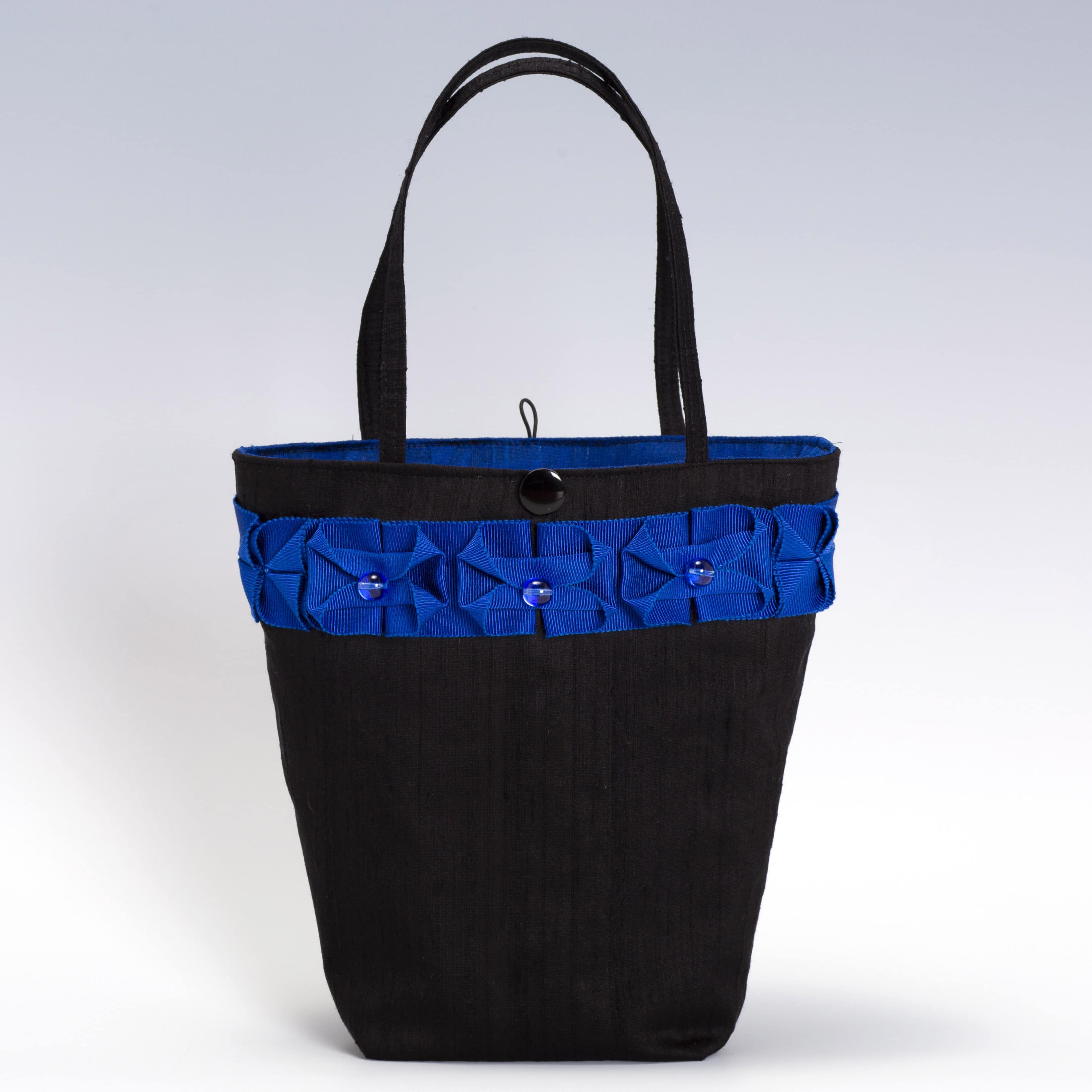 black silk handbag with blue ribbon trim and glass beads