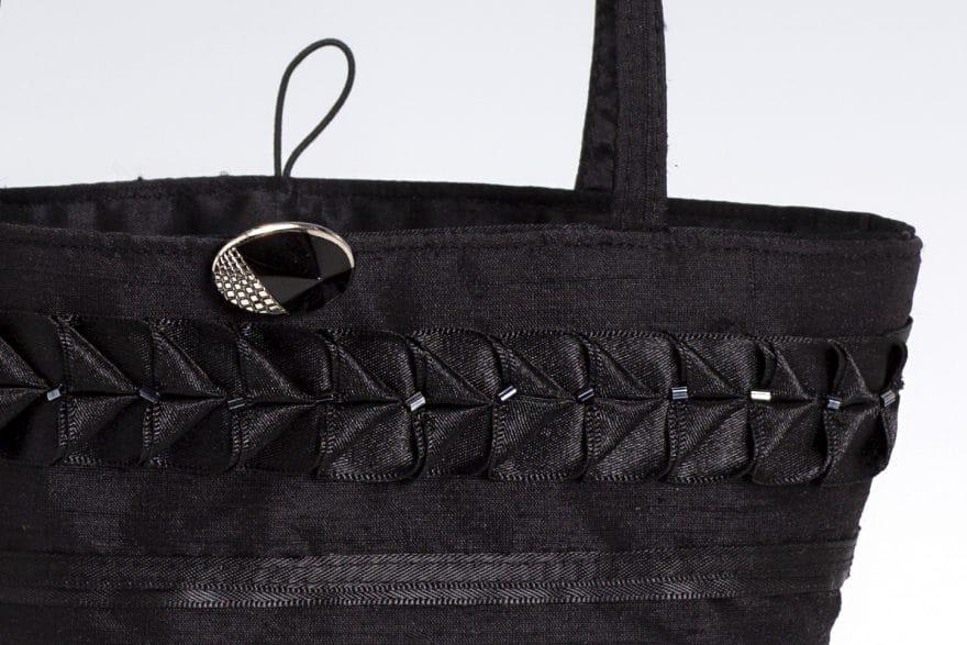 small black silk handbag detail of ribbon trim