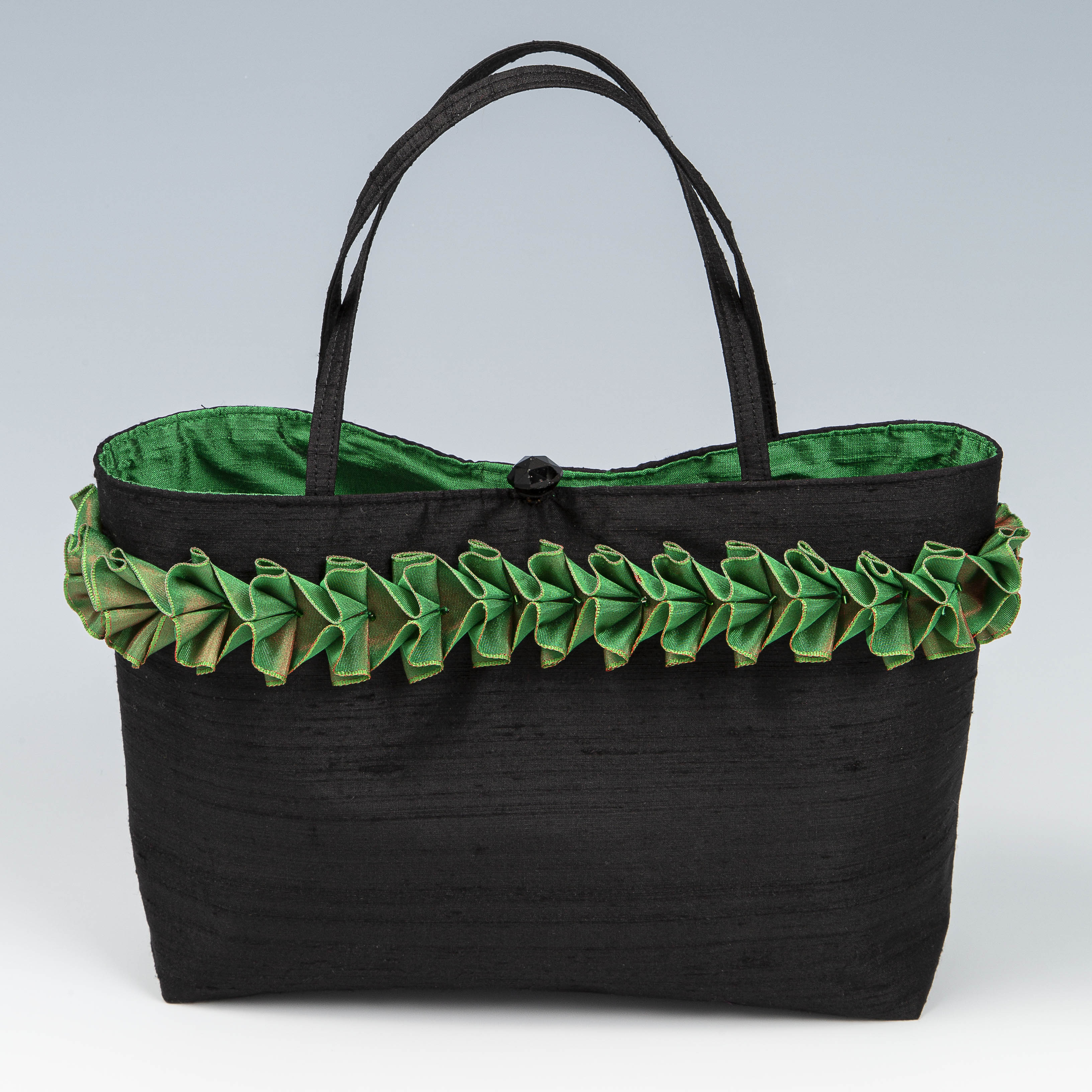 Black silk handbag with emerald silk lining